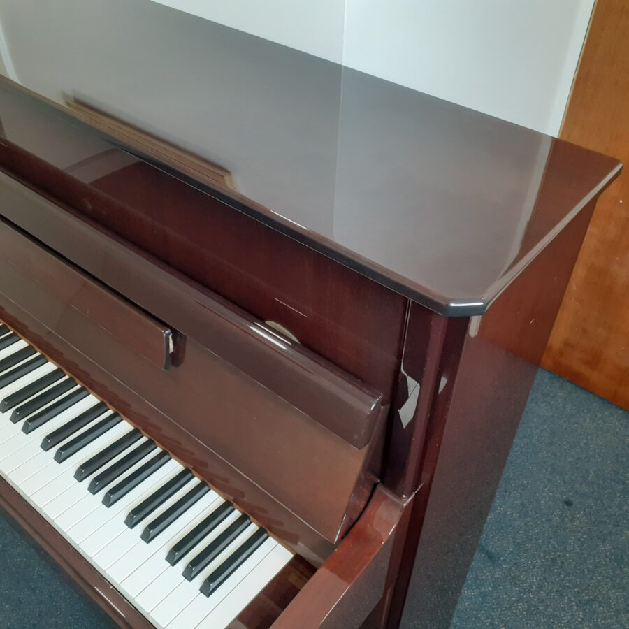 Yamaha V114 NS Silent upright piano mahogany finish corner detail