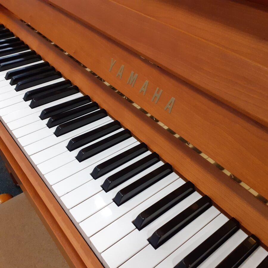 Yamaha P121 NT Upright Piano, SNC Keys and logo